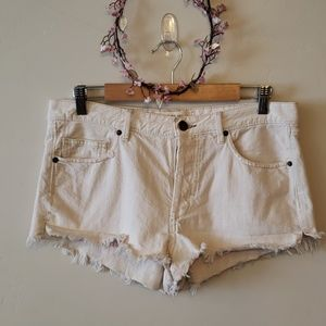 We the Free cream cutoff hi - rise denim shorts